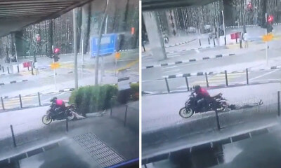Watch: Motorcyclist Mercilessly Dragged Woman Through Asphalt Driveway in KL to Steal Her Purse - WORLD OF BUZZ 7