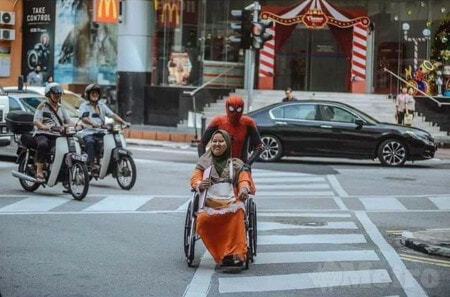 Spiderman spread his web to take care of disabled wife - WORLD OF BUZZ 1