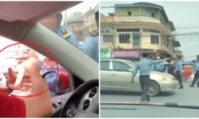 Man Openly Hands Bills of Cash To Traffic Officers, Get - WORLD OF BUZZ