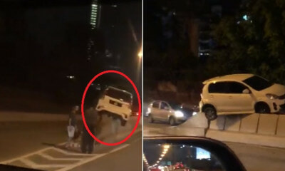 "Video: ""Flying"" Myvi Gets Stuck On Top Of Divider at JB, Netizens Amazed - WORLD OF BUZZ 2"
