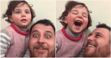 Father Creates Laughing Game To Distract Adorable Daughter From Explosions In Their City - WORLD OF BUZZ