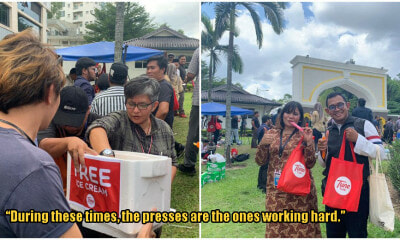 Photos: TuneTalk Gives Ice Cream, Water & Umbrellas To Tired Media As They Await Political Results - WORLD OF BUZZ 3
