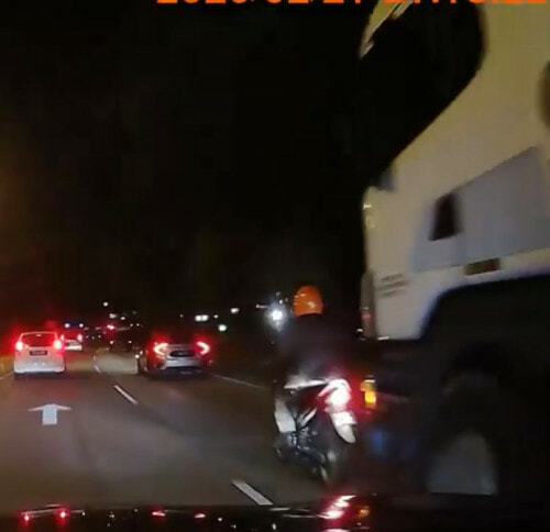 Watch: Biker Barely Escapes Getting Run Over By A Huge Truck - WORLD OF BUZZ 2
