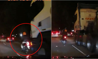 Watch: Biker Barely Escapes Getting Run Over By A Huge Truck - WORLD OF BUZZ 3