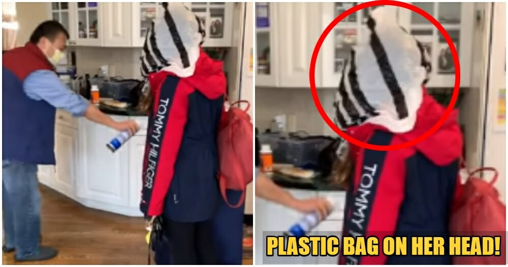 Watch: Concerned Dad Puts Plastic Bag On Daughter When He Sees Her Because Safety First - WORLD OF BUZZ