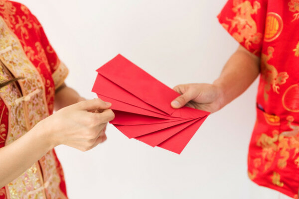 Male Hands Holding Many Blank Red Envelopes With Angpao Money With Chinese Costume 33842 940
